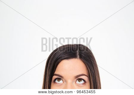 Cropped image of a woman looking up at copyspace isolated on a white background