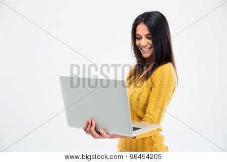 Happy beautiful woman using laptop isolated on a white background