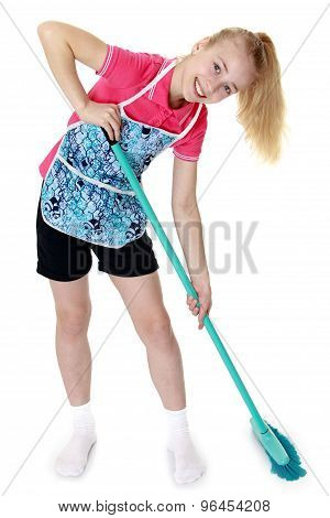 Girl sweeping the floor