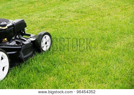 Lawn Mower In The Garden.