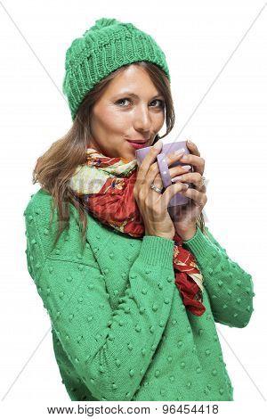 Pretty Woman In Winter Fashion Drinking Coffee