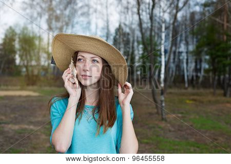 Freckled Girl In Hat Listening To Shell