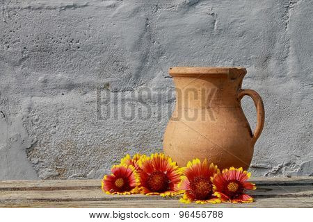Bright Flowers Near The Old Ceramic Jug