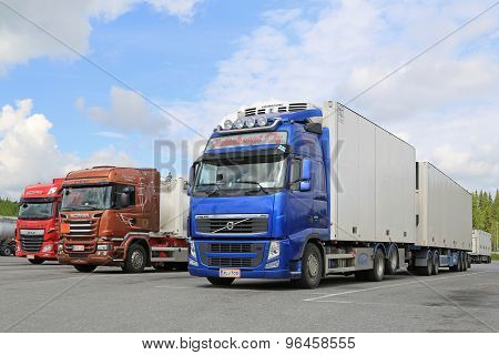 Volvo, Scania And DAF Trucks Parked At Truck Stop