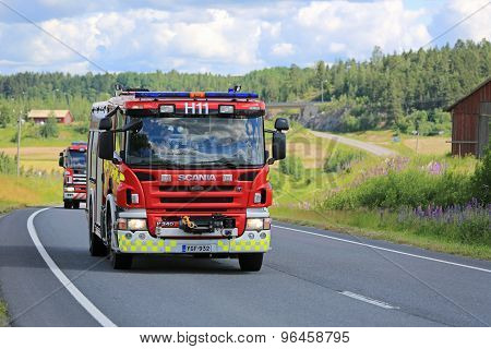 Two Scania Fire Trucks On The Road At Summer