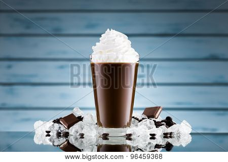 Iced Coffee In Glass And Crushed Ice On Blue Background