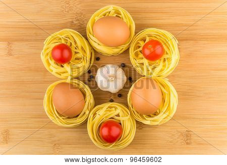 Fettuccine With Tomatoes, Eggs And Garlic On Wooden Board