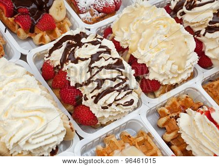 Strawberry Waffles With Cream And Chocolate Sauce
