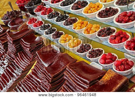 Strips Of Processed Sour Fruits And Bowls Of Traditionally Dried Plums And Cherries In Iran