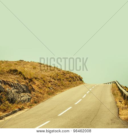 Empty Mountain Asphalt Road And Clear Blue Sky