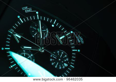 Clock Deal With Blue Green Illumination. Close-up