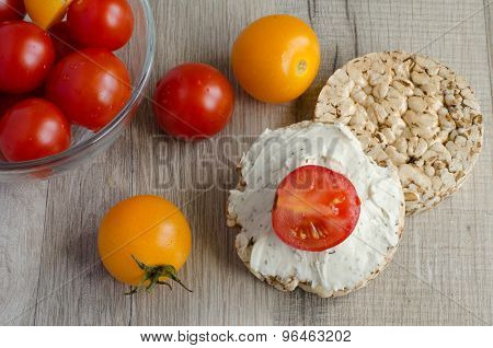 Red And Yellow Cherry Tomatoes And Crisp Bread