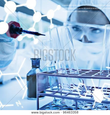 Protected female scientist dropping blue liquid in a test tube against science graphic
