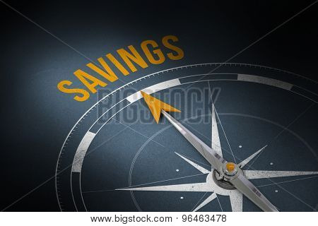 The word savings and compass against grey
