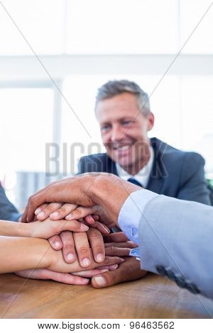 Business people joining hands together in the office