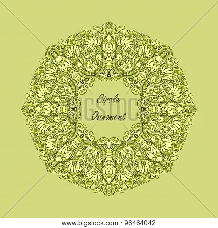 Circle ornament from doodle flowers on green background