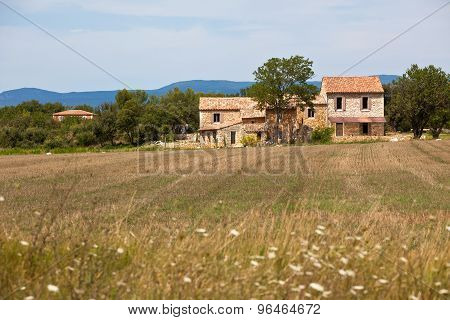 Stone House In A Harvested Field, France