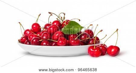 Sweet Cherries With Leaf On White Plate And Three Near