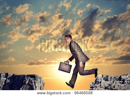 Businessman falling into abyss