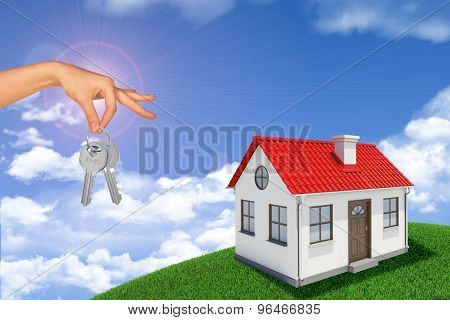 House with keys on hill