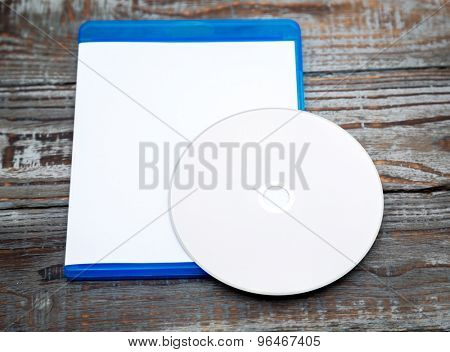 Blank compact disc with cover on wood background ground