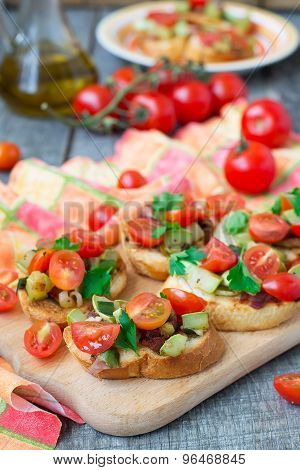 Bruschetta With Zucchini, Bacon, Green Onions And Cherry Tomatoes