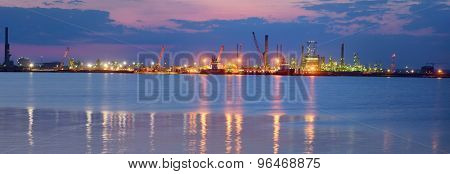 Oil and fuel production refinery in night time
