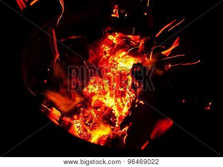 Embers And Sparks Flying From Fire