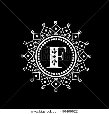 Creative monogram symbol with English Alphabet F in a beautiful floral frame on black background for your business.