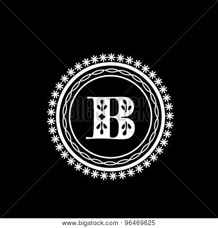 Stylish monogram design with English Alphabet B in a beautiful floral rounded frame on black background.