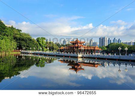 Vintage chinese pavillion over lake