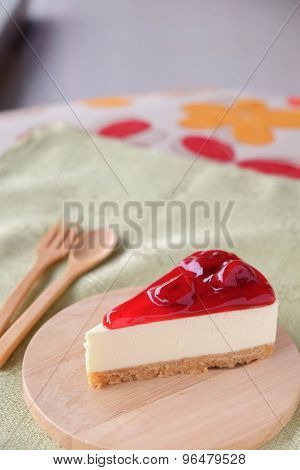 Strawberry cheese cake on wood plate
