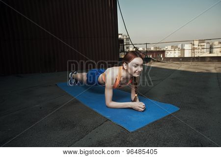 smiling lady does stretching during workout