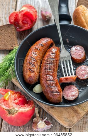 Frying Pan With Fried Sausage.