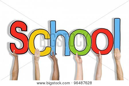 Multiethnic Group of Hands Holding Word School