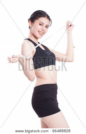 Fitness young woman taking measurements of her body. healthy concept