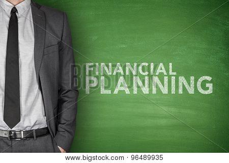 Financial planning text on green blackboard
