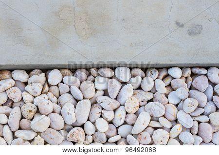 White Pebble Stones With Gray Concrete Ground