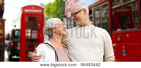 family, age, tourism, travel and people concept - happy senior couple over london city street in england