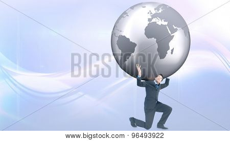 Businessman carrying the world against glowing abstract design