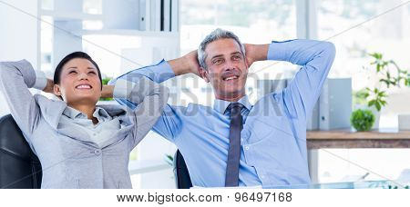Business people relaxing in swivel chair in office