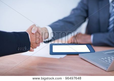 Two colleagues businessmen shaking hands at the office