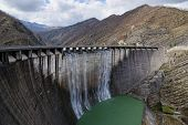 stock photo of dam  - dam with overflow with high jump of water - JPG