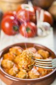 picture of meatball  - Meatballs with tomato sauce on the table of the kitchen - JPG
