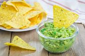 foto of nachos  - Bowl with chunky guacamole served with nachos - JPG