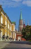 picture of arsenal  - view of Nikolskaya tower and the exposition of guns along the Kremlin Arsenal Moscow Russia - JPG