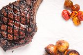 image of rib eye steak  - barbequed beef rib steak grilled to perfection with salad and potato - JPG