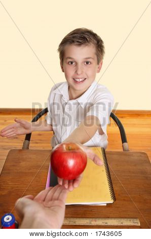 Student Giving Teacher An Apple