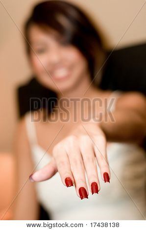 A young woman shows off her new polished nails
