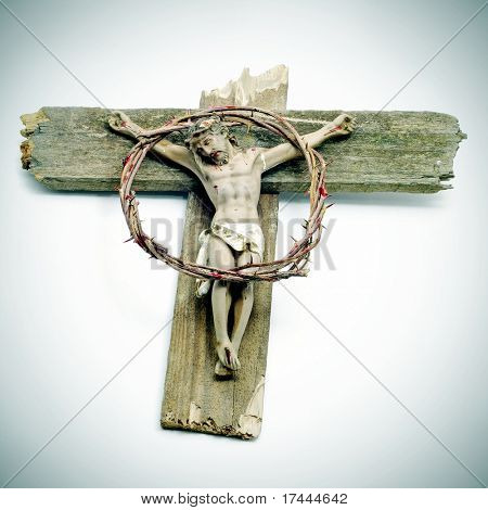 a figure of Jesus Christ in the cross and a bloody crown of thorns
